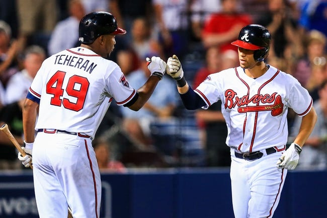 Apr 21, 2014; Atlanta, GA, USA; Atlanta Braves shortstop Andrelton Simmons (19) celebrates a solo home run with starting pitcher Julio Teheran (49) in the fifth inning against the Miami Marlins at Turner Field. Mandatory Credit: Daniel Shirey-USA TODAY Sports