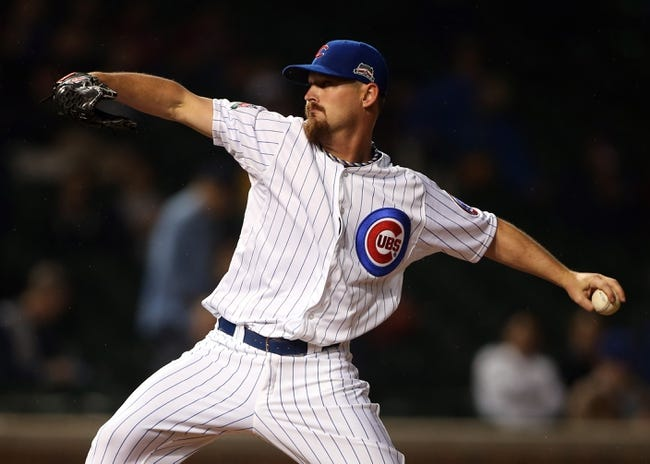 Apr 21, 2014; Chicago, IL, USA; Chicago Cubs starting pitcher Travis Wood throws a pitch against the Arizona Diamondbacks during the first inning at Wrigley Field. Mandatory Credit: Jerry Lai-USA TODAY Sports