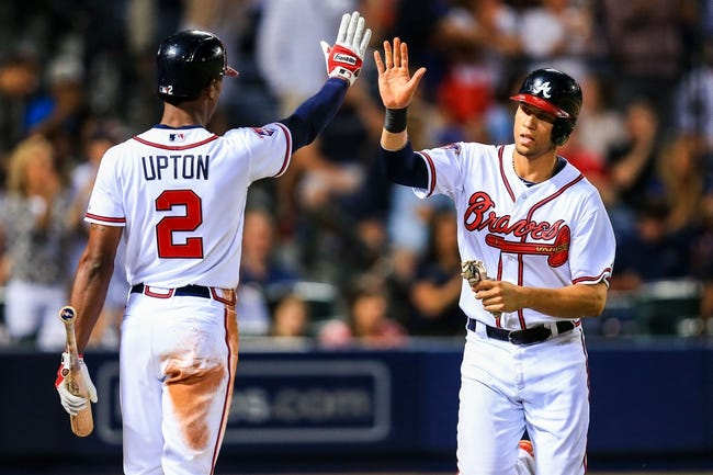 Apr 21, 2014; Atlanta, GA, USA; Atlanta Braves shortstop Andrelton Simmons (19) celebrates scoring on a right fielder Jason Heyward (not pictured) single with center fielder B.J. Upton (2) in the seventh inning against the Miami Marlins at Turner Field. Mandatory Credit: Daniel Shirey-USA TODAY Sports