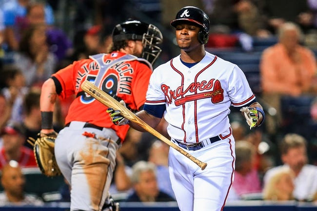 Apr 21, 2014; Atlanta, GA, USA; Atlanta Braves left fielder Justin Upton (8) reacts to striking out with the bases loaded in the seventh inning against the Miami Marlins at Turner Field. Mandatory Credit: Daniel Shirey-USA TODAY Sports