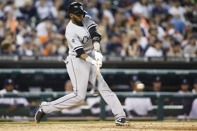 Apr 21, 2014; Detroit, MI, USA; Chicago White Sox shortstop Alexei Ramirez (10) hits an RBI single in the seventh inning against the Detroit Tigers at Comerica Park. Mandatory Credit: Rick Osentoski-USA TODAY Sports