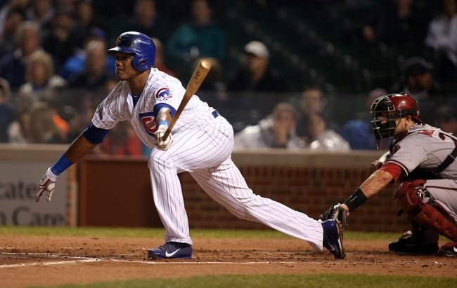 Apr 21, 2014; Chicago, IL, USA; Chicago Cubs shortstop Starlin Castro hits a single against the Arizona Diamondbacks during the second inning at Wrigley Field. Mandatory Credit: Jerry Lai-USA TODAY Sports
