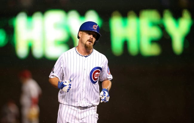 Apr 21, 2014; Chicago, IL, USA; Chicago Cubs starting pitcher Travis Wood rounds the bases after hitting a three-run home run against the Arizona Diamondbacks during the second inning at Wrigley Field. Mandatory Credit: Jerry Lai-USA TODAY Sports