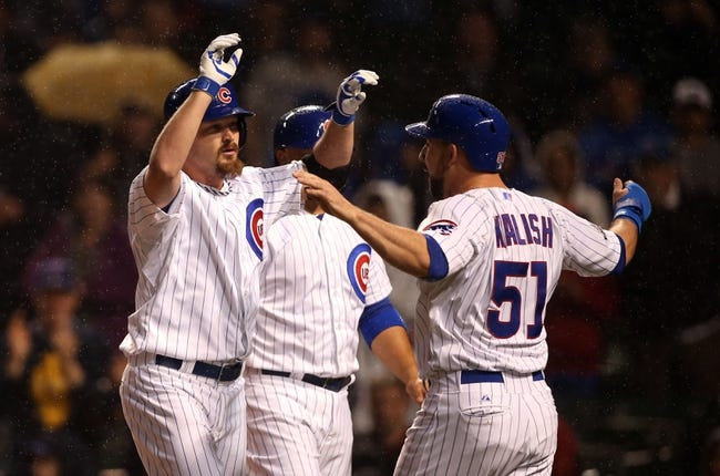 Apr 21, 2014; Chicago, IL, USA; Chicago Cubs starting pitcher Travis Wood (left) celebrates with left fielder Ryan Kalish (51) after hitting a three-run home run against the Arizona Diamondbacks during the second inning at Wrigley Field. Mandatory Credit: Jerry Lai-USA TODAY Sports