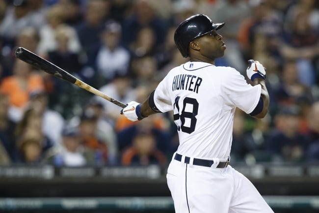 Apr 21, 2014; Detroit, MI, USA; Detroit Tigers right fielder Torii Hunter (48) hits a double in the eighth inning against the Chicago White Sox at Comerica Park. Mandatory Credit: Rick Osentoski-USA TODAY Sports