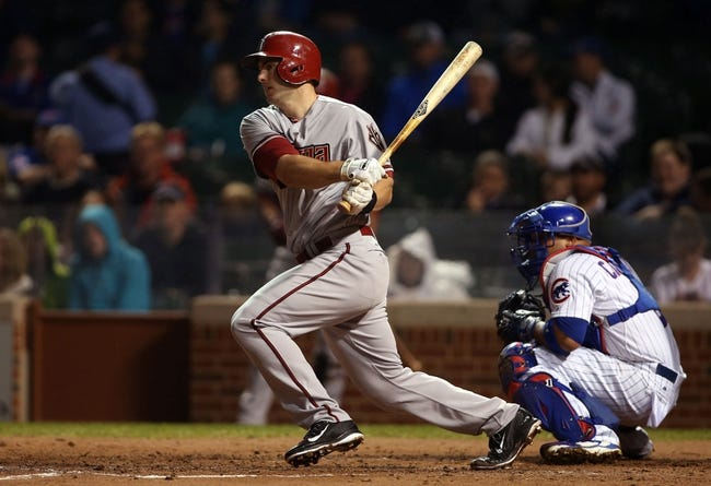 Apr 21, 2014; Chicago, IL, USA; Arizona Diamondbacks first baseman Paul Goldschmidt hits a single against the Chicago Cubs during the fourth inning at Wrigley Field. Mandatory Credit: Jerry Lai-USA TODAY Sports