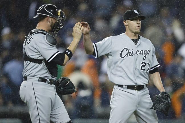 Apr 21, 2014; Detroit, MI, USA; Chicago White Sox catcher Tyler Flowers (21) and relief pitcher Matt Lindstrom (27) high five after the game against the Detroit Tigers at Comerica Park. Chicago won 3-1. Mandatory Credit: Rick Osentoski-USA TODAY Sports