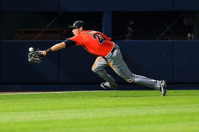 Apr 21, 2014; Atlanta, GA, USA; Miami Marlins left fielder Christian Yelich (21) makes a diving attempt on a Atlanta Braves center fielder Jordan Schafer (17) double in the ninth inning at Turner Field. Mandatory Credit: Daniel Shirey-USA TODAY Sports