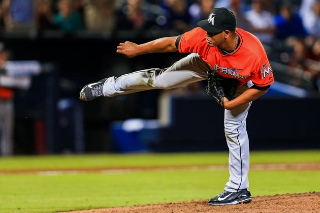 Apr 21, 2014; Atlanta, GA, USA; Miami Marlins starting pitcher Carlos Marmol (49) pitches in the ninth inning against the Atlanta Braves at Turner Field. Mandatory Credit: Daniel Shirey-USA TODAY Sports