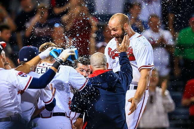 Apr 21, 2014; Atlanta, GA, USA; Atlanta Braves catcher Evan Gattis (24) celebrates a walk off two run home run in the tenth inning against the Miami Marlins at Turner Field. Mandatory Credit: Daniel Shirey-USA TODAY Sports