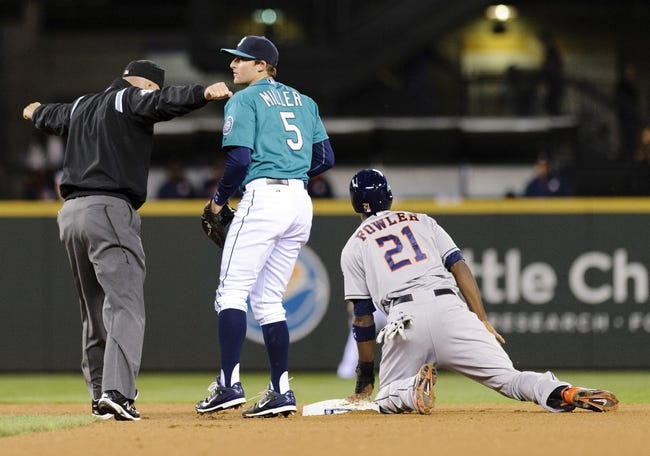 Apr 21, 2014; Seattle, WA, USA; Second base umpire Jeff Nelson signals Houston Astros center fielder Dexter Fowler (21) safe after Fowler stole second base during the fourth inning against the Seattle Mariners at Safeco Field. Mandatory Credit: Steven Bisig-USA TODAY Sports