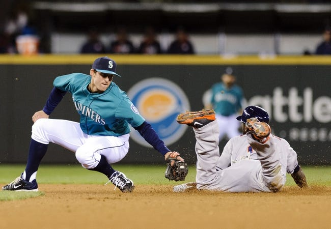 Apr 21, 2014; Seattle, WA, USA; Seattle Mariners shortstop Brad Miller (5) misses the tag on Houston Astros center fielder Dexter Fowler (21) during a stolen base in the fourth inning at Safeco Field. Mandatory Credit: Steven Bisig-USA TODAY Sports