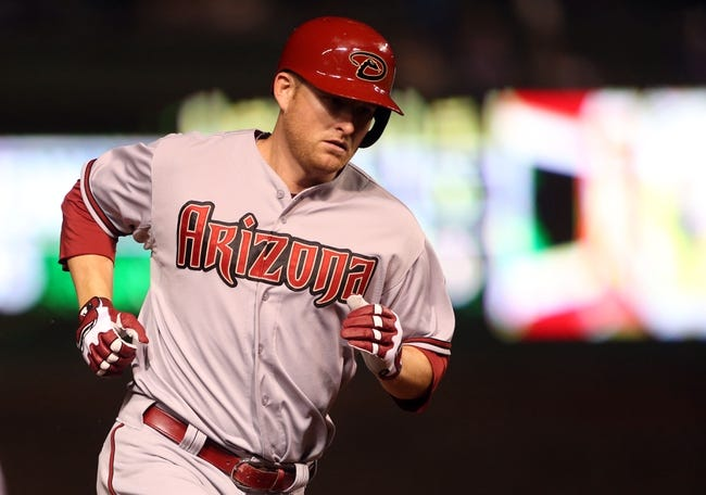 Apr 21, 2014; Chicago, IL, USA; Arizona Diamondbacks left fielder Mark Trumbo rounds the bases after hitting a solo home run against the Chicago Cubs during the seventh inning at Wrigley Field. Mandatory Credit: Jerry Lai-USA TODAY Sports