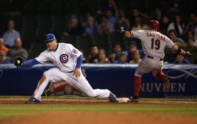 Apr 21, 2014; Chicago, IL, USA; Arizona Diamondbacks center fielder Tony Campana (19) is forced out by Chicago Cubs first baseman Anthony Rizzo (left) during the seventh inning at Wrigley Field. Mandatory Credit: Jerry Lai-USA TODAY Sports