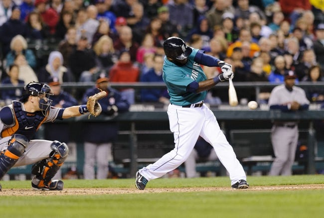Apr 21, 2014; Seattle, WA, USA; Seattle Mariners center fielder Abraham Almonte (36) hits a 2-run double against the Houston Astros during the fifth inning at Safeco Field. Mandatory Credit: Steven Bisig-USA TODAY Sports