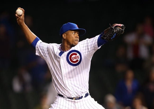 Apr 21, 2014; Chicago, IL, USA; Chicago Cubs relief pitcher Pedro Strop throws a pitch against the Arizona Diamondbacks during the ninth inning at Wrigley Field. Mandatory Credit: Jerry Lai-USA TODAY Sports