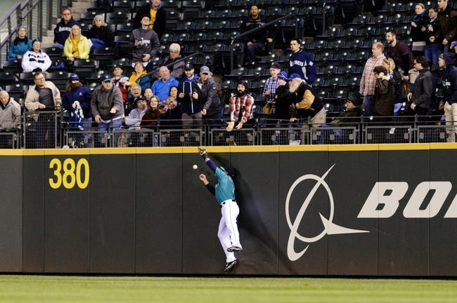 Apr 21, 2014; Seattle, WA, USA; Seattle Mariners right fielder Stefen Romero (7) misses a fly ball hit by Houston Astros left fielder Alex Presley (8) during the sixth inning at Safeco Field. Mandatory Credit: Steven Bisig-USA TODAY Sports