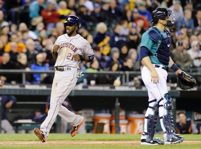 Apr 21, 2014; Seattle, WA, USA; Houston Astros center fielder Dexter Fowler (21) scores a run off a RBI single hit by Houston Astros first baseman Marc Krauss (18) (not pictured) during the sixth inning against the Seattle Mariners at Safeco Field. Mandatory Credit: Steven Bisig-USA TODAY Sports
