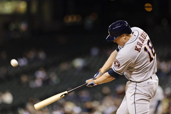 Apr 21, 2014; Seattle, WA, USA; Houston Astros first baseman Marc Krauss (18) hits a solo home run against the Seattle Mariners during the eighth inning at Safeco Field. Mandatory Credit: Steven Bisig-USA TODAY Sports