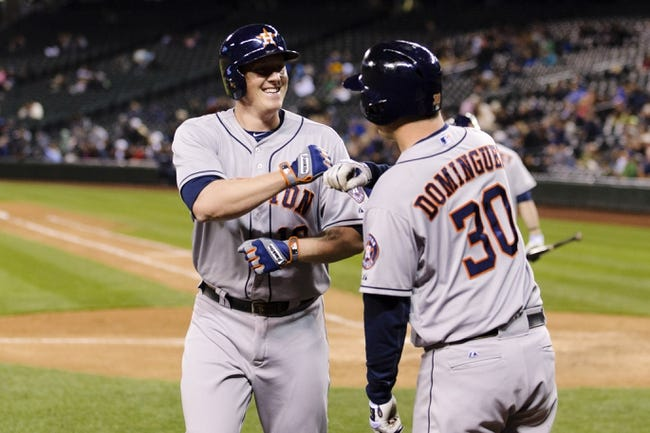 Apr 21, 2014; Seattle, WA, USA; Houston Astros first baseman Marc Krauss (18) and designated hitter Matt Dominguez (30) celebrate after Krauss hit a solo home run against the Seattle Mariners during the eighth inning at Safeco Field. Mandatory Credit: Steven Bisig-USA TODAY Sports