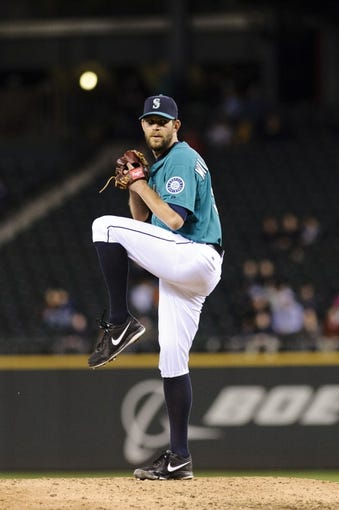 Apr 21, 2014; Seattle, WA, USA; Seattle Mariners relief pitcher Tom Wilhelmsen (54) pitches to the Houston Astros during the eighth inning at Safeco Field. Mandatory Credit: Steven Bisig-USA TODAY Sports
