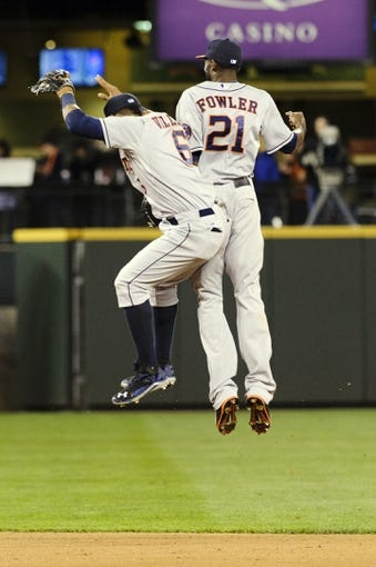 Apr 21, 2014; Seattle, WA, USA; Houston Astros shortstop Jonathan Villar (6) and center fielder Dexter Fowler (21) celebrate after defeating the Seattle Mariners at Safeco Field. Houston defeated Seattle 7-2. Mandatory Credit: Steven Bisig-USA TODAY Sports