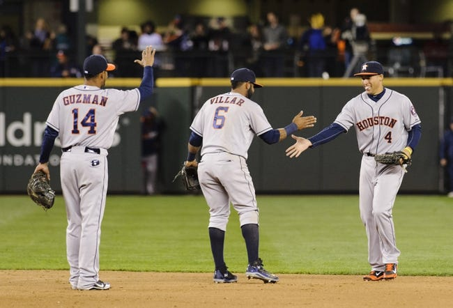 Apr 21, 2014; Seattle, WA, USA; Houston Astros shortstop Jonathan Villar (6) celebrates with teammates after defeating the Seattle Mariners at Safeco Field. Houston defeated Seattle 7-2. Mandatory Credit: Steven Bisig-USA TODAY Sports