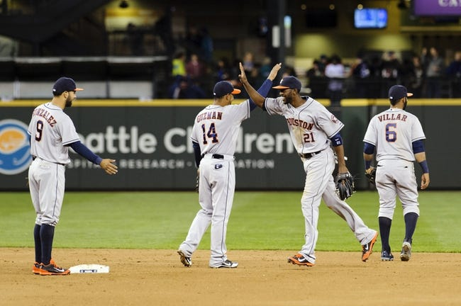 Apr 21, 2014; Seattle, WA, USA; Houston Astros first baseman Jesus Guzman (14) and center fielder Dexter Fowler (21) high-five after defeating the Seattle Mariners at Safeco Field. Houston defeated Seattle 7-2. Mandatory Credit: Steven Bisig-USA TODAY Sports
