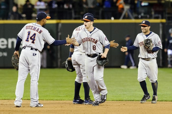 Apr 21, 2014; Seattle, WA, USA; Houston Astros first baseman Jesus Guzman (14) and left fielder Alex Presley (8) celebrate after defeating the Seattle Mariners at Safeco Field. Houston defeated Seattle 7-2. Mandatory Credit: Steven Bisig-USA TODAY Sports