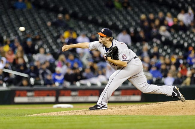 Apr 21, 2014; Seattle, WA, USA; Houston Astros relief pitcher Matt Albers (37) pitches to the Seattle Mariners during the eighth inning at Safeco Field. Houston defeated Seattle 7-2. Mandatory Credit: Steven Bisig-USA TODAY Sports