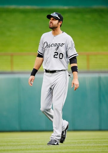 Apr 19, 2014; Arlington, TX, USA; Chicago White Sox left fielder Jordan Danks (20) before the game against the Texas Rangers at Globe Life Park in Arlington. Texas won 6-3. Mandatory Credit: Kevin Jairaj-USA TODAY Sports