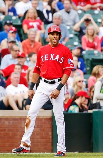 Apr 19, 2014; Arlington, TX, USA; Texas Rangers right fielder Alex Rios (51) reacts during the game against the Chicago White Sox at Globe Life Park in Arlington. Texas won 6-3. Mandatory Credit: Kevin Jairaj-USA TODAY Sports