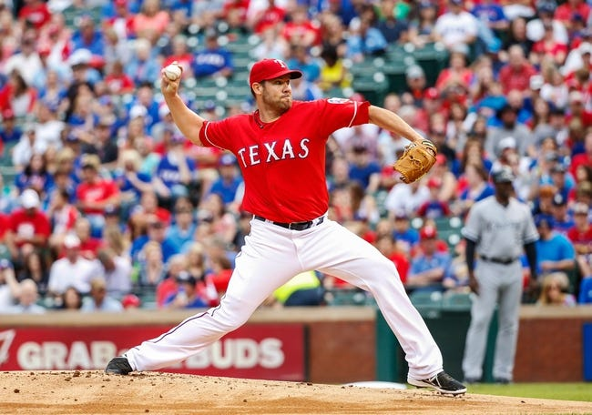 Apr 19, 2014; Arlington, TX, USA; Texas Rangers starting pitcher Colby Lewis (48) throws during the game against the Chicago White Sox at Globe Life Park in Arlington. Texas won 6-3. Mandatory Credit: Kevin Jairaj-USA TODAY Sports
