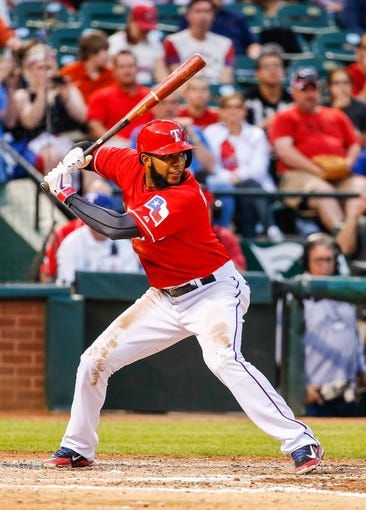 Apr 19, 2014; Arlington, TX, USA; Texas Rangers shortstop Elvis Andrus (1) bats during the game against the Chicago White Sox at Globe Life Park in Arlington. Texas won 6-3. Mandatory Credit: Kevin Jairaj-USA TODAY Sports