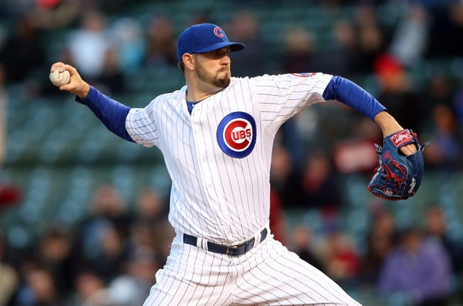 Apr 22, 2014; Chicago, IL, USA; Chicago Cubs starting pitcher Jason Hammel throws a pitch against the Arizona Diamondbacks during the first inning at Wrigley Field. Mandatory Credit: Jerry Lai-USA TODAY Sports