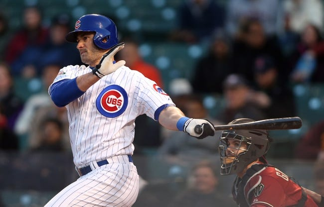 Apr 22, 2014; Chicago, IL, USA; Chicago Cubs outfielder Justin Ruggiano hits a single against the Arizona Diamondbacks during the first inning at Wrigley Field. Mandatory Credit: Jerry Lai-USA TODAY Sports
