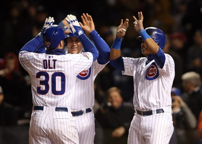 Apr 22, 2014; Chicago, IL, USA; Chicago Cubs third baseman Mike Olt (30) is congratulated by teammates Starlin Castro (right) and Anthony Rizzo after hitting a three-run home run against the Arizona Diamondbacks during the fifth inning at Wrigley Field. Mandatory Credit: Jerry Lai-USA TODAY Sports