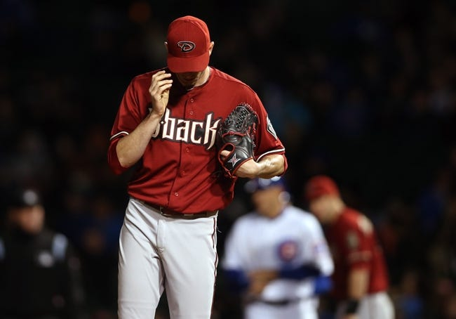 Apr 22, 2014; Chicago, IL, USA; Arizona Diamondbacks starting pitcher Brandon McCarthy reacts after giving up a run to the Chicago Cubs during the fifth inning at Wrigley Field. Mandatory Credit: Jerry Lai-USA TODAY Sports