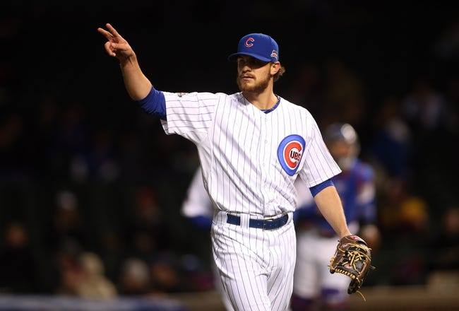 Apr 22, 2014; Chicago, IL, USA; Chicago Cubs starting pitcher Justin Grimm reacts after retiring the Arizona Diamondbacks during the eighth inning at Wrigley Field. Mandatory Credit: Jerry Lai-USA TODAY Sports