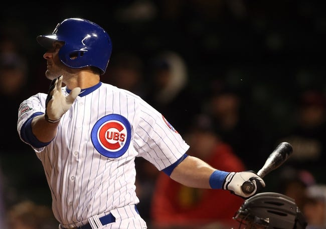 Apr 22, 2014; Chicago, IL, USA; Chicago Cubs outfielder Justin Ruggiano hits a two-run single against the Arizona Diamondbacks during the eighth inning at Wrigley Field. Mandatory Credit: Jerry Lai-USA TODAY Sports