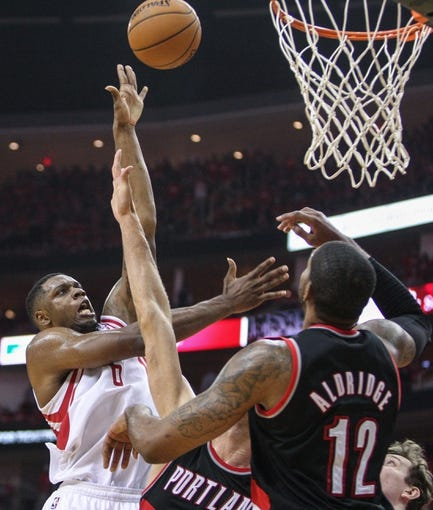 Apr 20, 2014; Houston, TX, USA; Houston Rockets forward Terrence Jones (6) shoots during the third quarter as Portland Trail Blazers forward LaMarcus Aldridge (12) defends in game one during the first round of the 2014 NBA Playoffs at Toyota Center. Mandatory Credit: Troy Taormina-USA TODAY Sports