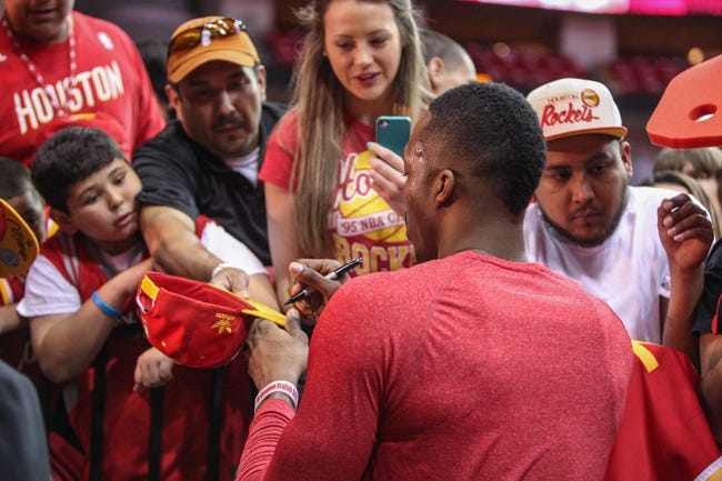 Apr 20, 2014; Houston, TX, USA; Houston Rockets center Dwight Howard (12) signs autographs for fans before game one against the Portland Trail Blazers during the first round of the 2014 NBA Playoffs at Toyota Center. Mandatory Credit: Troy Taormina-USA TODAY Sports