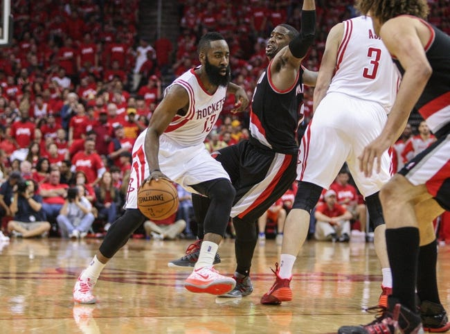 Apr 20, 2014; Houston, TX, USA; Houston Rockets guard James Harden (13) drives the ball during the third quarter as Portland Trail Blazers guard Wesley Matthews (2) defends in game one during the first round of the 2014 NBA Playoffs at Toyota Center. Mandatory Credit: Troy Taormina-USA TODAY Sports