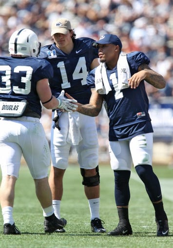 Apr 12, 2014; State College, PA, USA; Penn State Nittany Lions quarterback Christian Hackenberg (14) and running back Bill Belton (1) congratulate running back Cole Chiappialle (33) after scoring a touchdown in the second quarter of the Blue White spring game at Beaver Stadium. The Blue team defeated the White team 37-0. Mandatory Credit: Matthew O'Haren-USA TODAY Sports