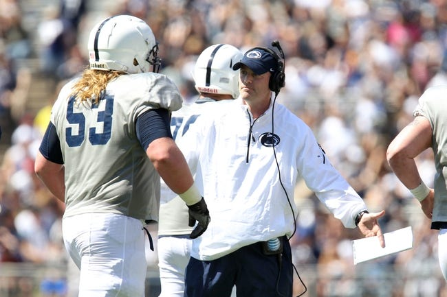 Apr 12, 2014; State College, PA, USA; Penn State Nittany Lions offensive coordinator/tight ends coach John Donovan high-fives guard Derek Dowrey (53) in the second quarter of the Blue White spring game at Beaver Stadium. The Blue team defeated the White team 37-0. Mandatory Credit: Matthew O'Haren-USA TODAY Sports
