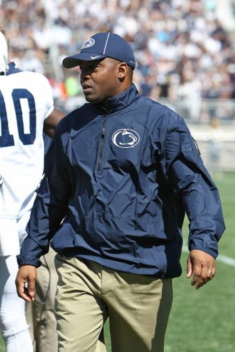 Apr 12, 2014; State College, PA, USA; Penn State Nittany Lions defensive line coach Sean Spencer walks off the field in the second quarter of the Blue White spring game at Beaver Stadium. The Blue team defeated the White team 37-0. Mandatory Credit: Matthew O'Haren-USA TODAY Sports