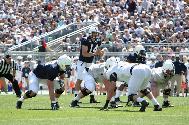 Apr 12, 2014; State College, PA, USA; Penn State Nittany Lions quarterback Christian Hackenberg (14) at the line of scrimmage in the first quarter of the Blue White spring game at Beaver Stadium. The Blue team defeated the White team 37-0. Mandatory Credit: Matthew O'Haren-USA TODAY Sports
