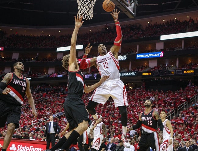 Apr 20, 2014; Houston, TX, USA; Houston Rockets center Dwight Howard (12) attempts a shot during the fourth quarter against the Portland Trail Blazers in game one during the first round of the 2014 NBA Playoffs at Toyota Center. Mandatory Credit: Troy Taormina-USA TODAY Sports