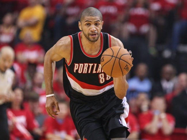 Apr 20, 2014; Houston, TX, USA; Portland Trail Blazers forward Nicolas Batum (88) brings the ball up the court during the first quarter against the Houston Rockets in game one during the first round of the 2014 NBA Playoffs at Toyota Center. Mandatory Credit: Troy Taormina-USA TODAY Sports