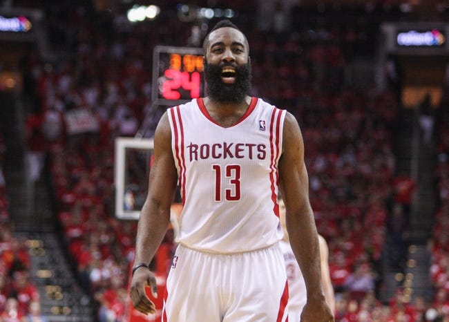 Apr 20, 2014; Houston, TX, USA; Houston Rockets guard James Harden (13) reacts after a play during the third quarter against the Portland Trail Blazers in game one during the first round of the 2014 NBA Playoffs at Toyota Center. Mandatory Credit: Troy Taormina-USA TODAY Sports